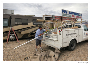 Alex gets new awning toppers at our boondocking site