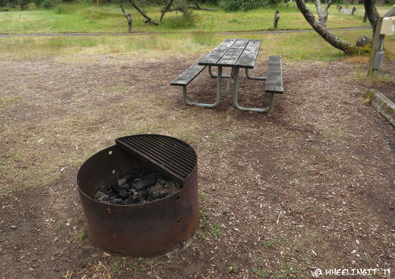Picnic table & fire-pit in each site