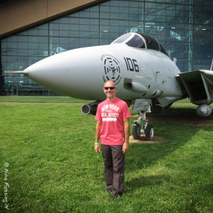 Paul poses in front of an F-14 Tomcat