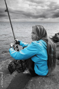 A touch of blue on a grey day. Fishing on the pier at Cape D.