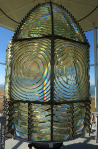 """Our amazing Frenel Lens. She's 6'8"""" tall and 4'8"""" wide. See the little stool on the right?"""