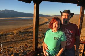 Soft red light illuminates Chris & Cherie against dry Washoe Lake